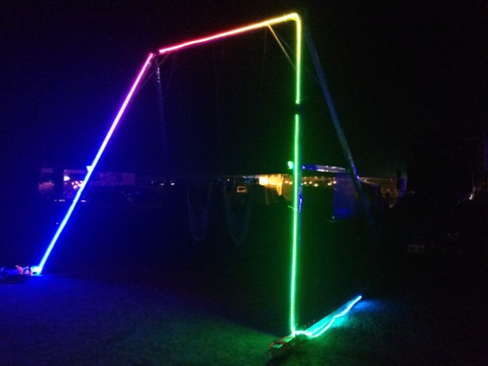 The swing illuminated with programmed LEDs at night.
